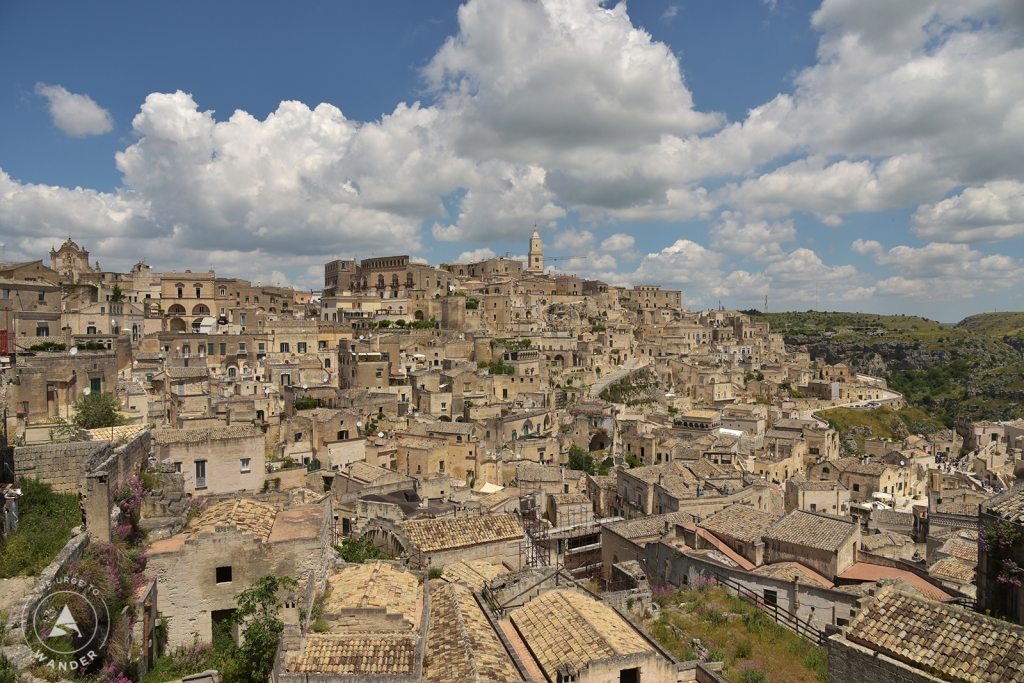 Dramatic view of Matera City with puffy clouds above.