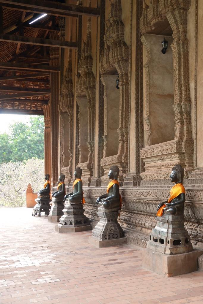 Row of bronze Buddhas in Wat Haw Phra Kaew.