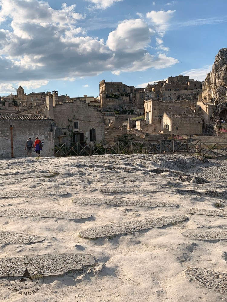 Graves on the top level that form the roof of caves beneath. Matera Travel Guide.
