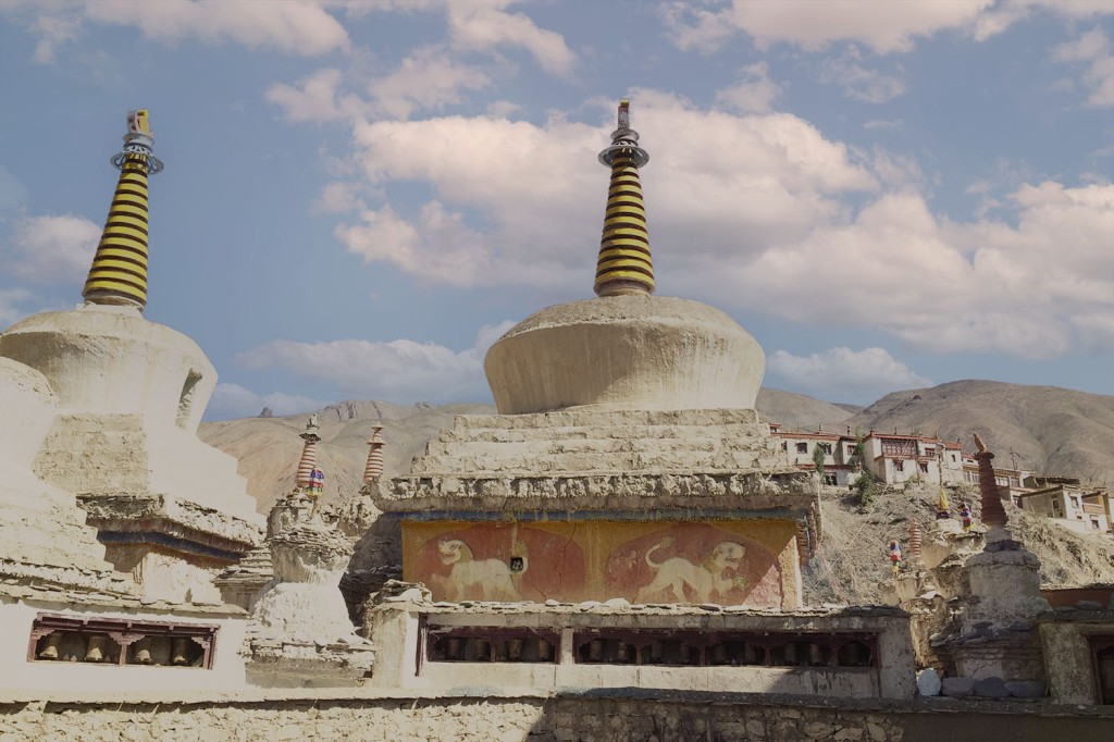 Chortens of Lamayuru with unique white lion reliefs on ochre coloured bands at the bottom.