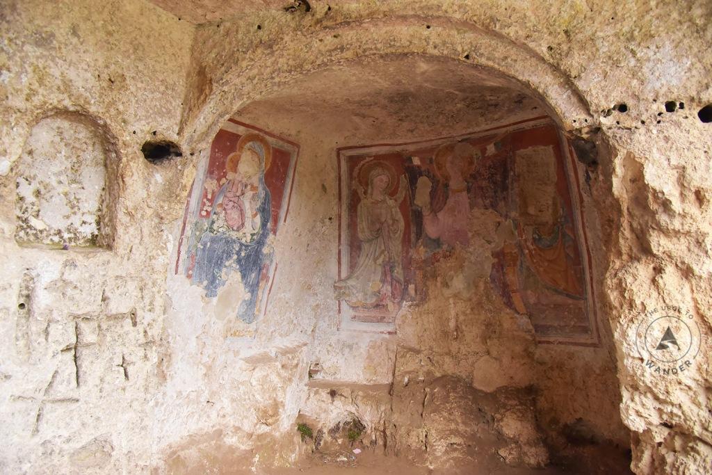 Fading frescoes in the church of Madonna delle Tre Porte in the Murgia Matarena Park in Matera, Italy.